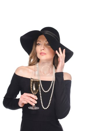 elegant woman in straw holding champagne glass isolated on white background