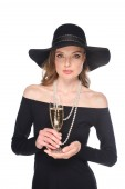 beautiful woman in straw holding champagne glass and looking at camera isolated on white background