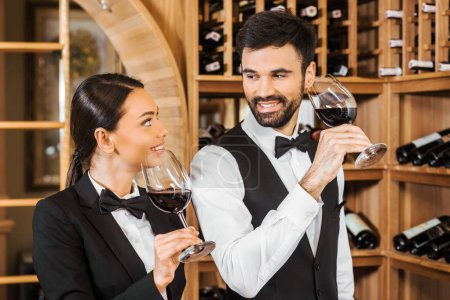 couple of happy wine stewards making degustation together and chatting at wine store