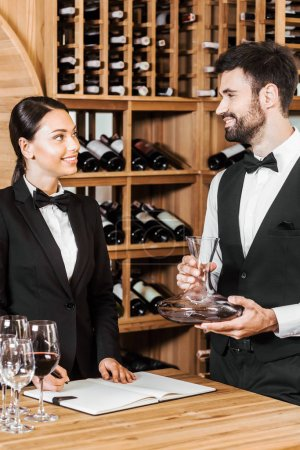 couple of wine stewards counting glassware at wine store