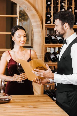 wine steward giving consultation to female client at wine store