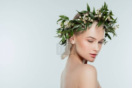 nude attractive girl in floral wreath, isolated on grey, natural beauty