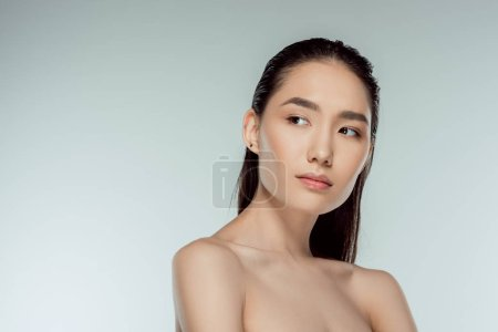 beautiful asian young woman, isolated on grey