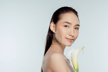 Photo for Attractive asian girl with calla flower, isolated on grey - Royalty Free Image