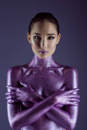asian girl in ultra violet glitter, isolated on purple