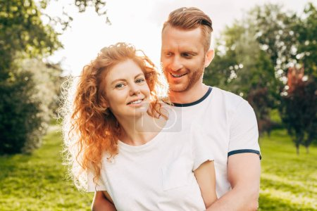 Photo for Beautiful happy redhead couple spending time together in park - Royalty Free Image