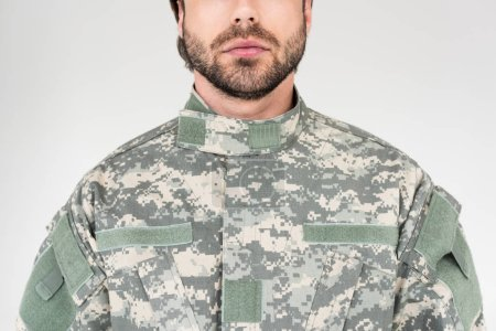 cropped shot of soldier in military uniform isolated on grey