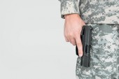 """Постер, картина, фотообои """"Обрезанный снимок мужчин солдат в военной форме, держа пистолет, изолированные на серый"""""""