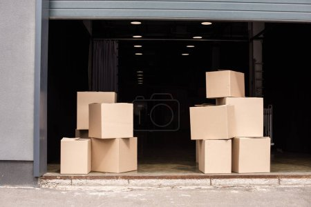 cardboard boxes on each other near open garage