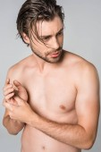 portrait of thoughtful shirtless man with stylish hairstyle isolated on grey
