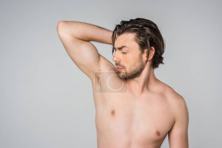 Photo for Portrait of handsome shirtless man with arm up isolated on grey - Royalty Free Image