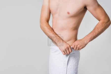 Photo for Partial view of man in white towel isolated on grey - Royalty Free Image