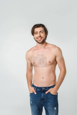 Photo for Portrait of happy shirtless man in jeans isolated on grey - Royalty Free Image