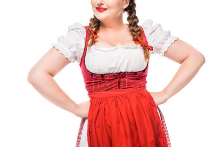 cropped image of oktoberfest waitress in traditional german dress with hands on waist isolated on white background