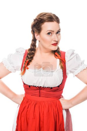 beautiful oktoberfest waitress in traditional bavarian dress standing with hands on waist isolated on white background