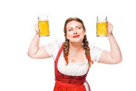 Photo for Smiling oktoberfest waitress in traditional bavarian dress showing mugs of light beer isolated on white background - Royalty Free Image