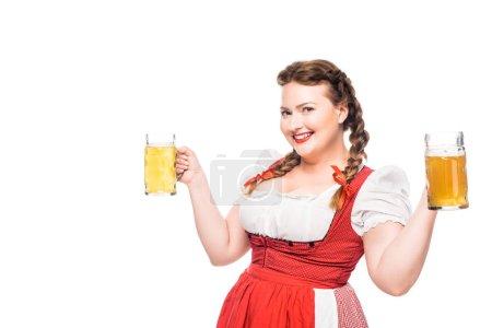happy oktoberfest waitress in traditional bavarian dress holding mugs of light beer isolated on white background