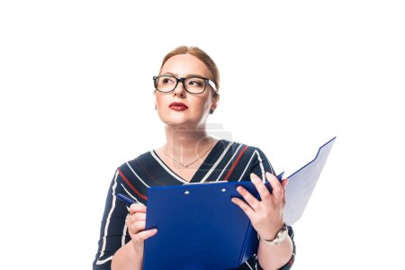 pensive businesswoman in eyeglasses writing in clipboard isolated on white background