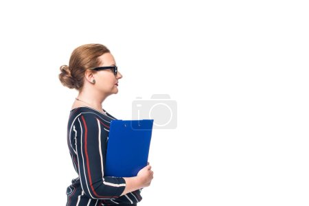 side view of businesswoman in eyeglasses holding clipboard isolated on white background