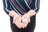 cropped image of female estate agent showing keys from house isolated on white background