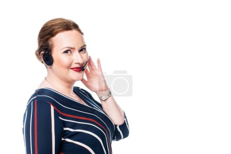 smiling female operator of call center with headset looking at camera isolated on white background