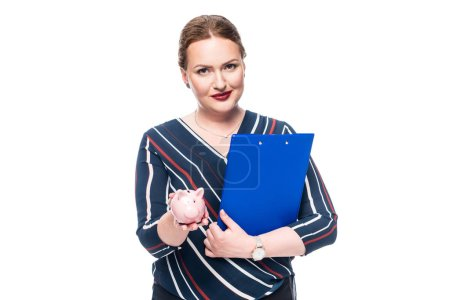 Photo for Smiling female accountant with clipboard showing pink piggy bank isolated on white background - Royalty Free Image