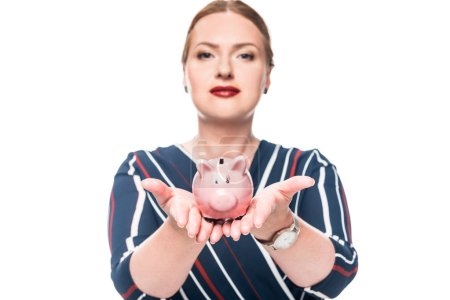 beautiful female accountant showing pink piggy bank isolated on white background