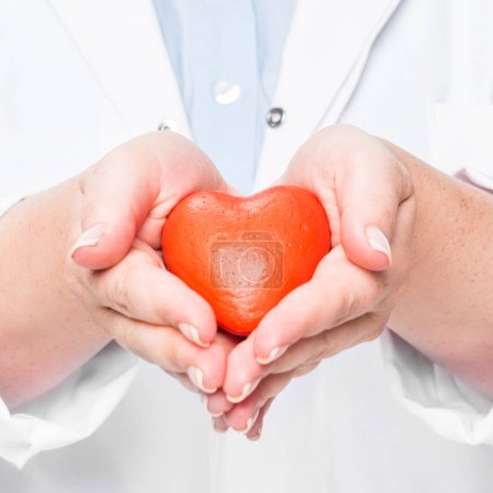 partial view of female doctor in white coat showing heart symbol