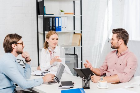 team of successful business partners having conversation at conference room of modern office