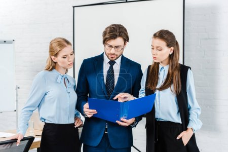 businesswomen showing papers to their boss at modern office