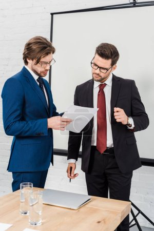 businessmen working with documents together at conference room