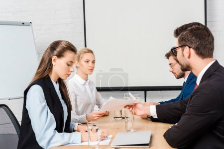 team of business people having meeting at modern office