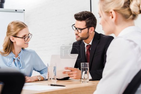 team of business partners having conversation at modern office