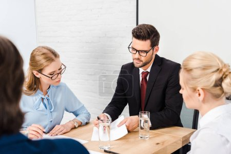 team of business people having conversation at modern office