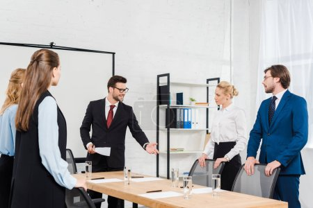 team of boss and managers having conversation at modern office