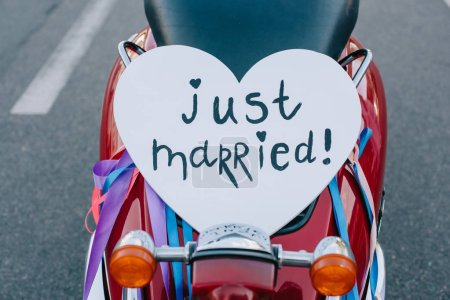 "close up of scooter with ""just married"" heart symbol for wedding"