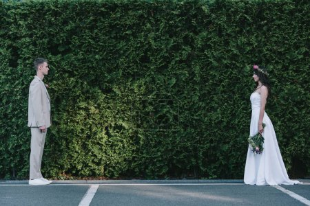groom and bride standing opposite each other before wedding