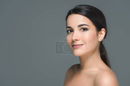 Photo for Portrait of brunette smiling woman looking at camera isolated on grey - Royalty Free Image