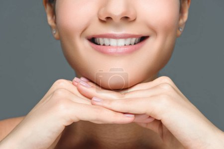 Photo for Partial view of smiling woman with white teeth isolated on grey - Royalty Free Image