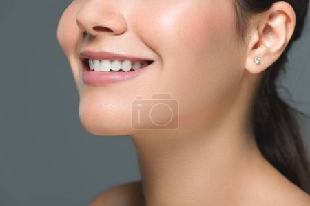 cropped shot of smiling woman with beautiful white teeth isolated on grey