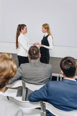 Photo for Attractive business coach and businesswoman talking at training in hub - Royalty Free Image