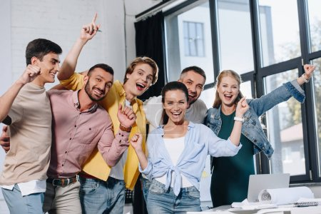 happy businesspeople looking at camera in office