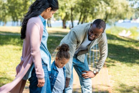 Photo for African american parents and daughter standing in park - Royalty Free Image