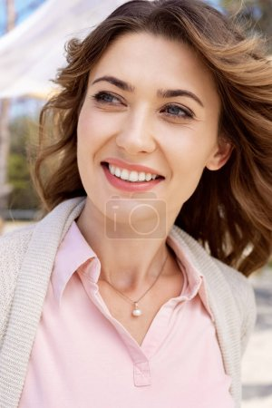 portrait of beautiful smiling woman looking away
