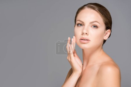 portrait of beautiful woman with nude makeup isolated on grey