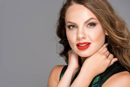 portrait of beautiful woman with red lipstick on lips posing isolated on grey