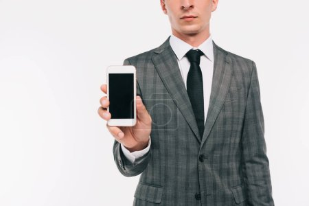 cropped image of businessman showing smartphone isolated on white