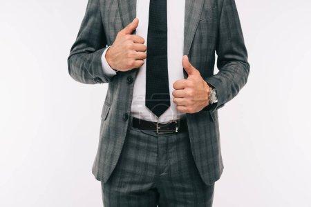 cropped image of businessman holding jacket isolated on white