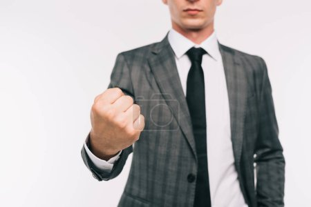 cropped image of businessman showing fist isolated on white