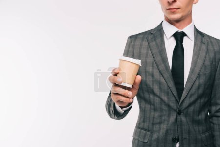 cropped image of businessman holding coffee in paper cup isolated on white